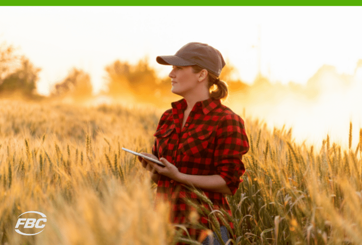 year end tax planning farmers woman with tablet in field
