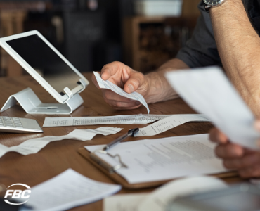 small business owner examines receipts for tax deductions