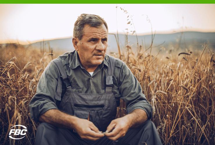 farmer sitting in field